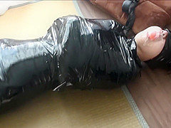 Japanese girl mumified and gagged with clear medical tape