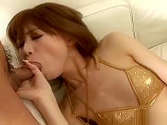 Asian cuttie in her golden bikini sucking a hard cock