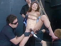 Sexy Oriental woman orgasms with toys as she's tied and suspended with rope