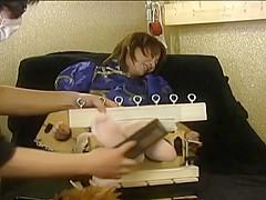 Japanese girl tickled in stocks