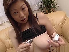 Busty babe Nana Masaki fucks her pussy with big dildos