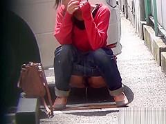 Asian whore pees behind car