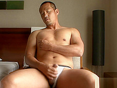 Japanese Muscle Daddy Jerking Off
