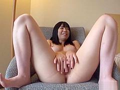 Hot Asian honey enjoys caressing her juicy large melons