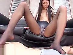 Hot Japanese footjob in black pantyhose