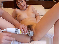 Horny Japanese chick gets her pussy wet with large dildo