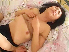 Horny Japanese MILF enjoys hot jizz on her face
