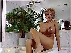 Big tit milf taking a bath